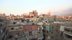 Stock Video Footage of Pan shot over the roofs of Shatila refugee neighborhood, Beirut, Lebanon