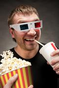 Funny man watching 3D movie Stock Photos