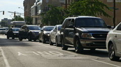 cars being stuck in traffic in downtown of a city. Stock Footage