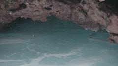 Water Ocean Rocks Hole slow motion Stock Footage