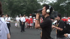 Chinese news crew filming, Beijing Olympics Stock Footage