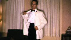Man in Tuxedo Taking Off Coat Formal 1960s Vintage Film Retro Home Movie 8549 Stock Footage