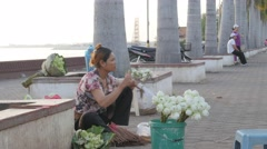 Woman making flower offerings at Dorngkeur shrine,Phnom Penh,Cambodia Stock Footage