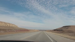 Timelapse of car driving through valley area on highway Stock Footage