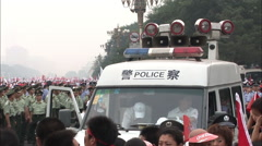 Police van & Chinese soldiers, Beijing China Stock Footage