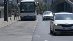 Driving cars and a yellow bus on Tytusa Chalubinskiego street, Warsaw Stock Footage