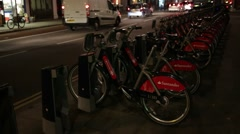 Boris bikes (public transport bikes) in the night, London Stock Footage