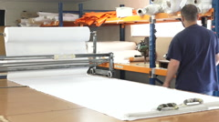 Worker cut new fabric sheet for the new National flag of New Zealand Stock Footage