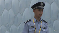 Water Cube Olympic Stadium, police, Beijing Stock Footage