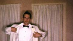 Man in Tuxedo Putting On Coat Formal 1960s Vintage Film Retro Home Movie 8550 Stock Footage
