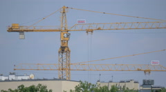 Two tower cranes on a cloudy day in Warsaw Stock Footage