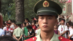 Chinese soldier close-up, Olympic crowds Stock Footage