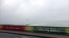 Beijing Airport, airplane landing, China Stock Footage