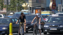 Couple on bikes and other cars waiting at the traffic light, Warsaw Stock Footage