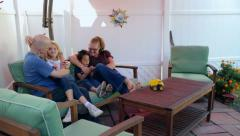 Family unites on outdoor patio in summertime - stock footage