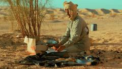 A sahara man washing dishes Stock Footage