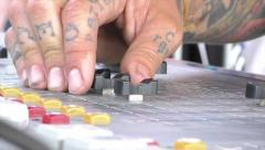 Faders on audio board self-adjust as tech makes adjustment Stock Footage