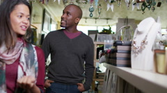 4K Cheerful couple browsing together in small boutique shop Stock Footage