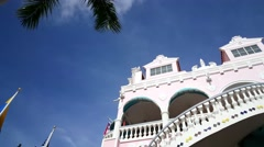 Pan from Colorful Royal Plaza Mall in Oranjestad Aruba Stock Footage
