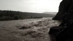 Stock Video Footage of bubbling stream of water, the Mongolian mountain river in the rain near the