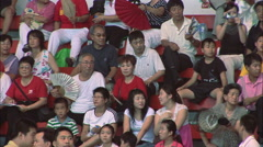 Chinese spectators in stadium, waving fans Stock Footage