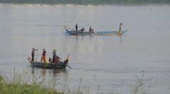 Fishermen in small boat on Tonle Sap River,Phnom Penh,Cambodia - stock footage