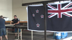 Workers print the National New Zealand flag Stock Footage
