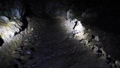 Exploring Kaeleku lava tube, Maui, Hawaii - stock footage