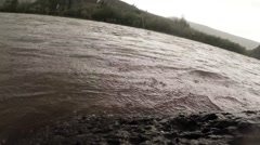 Mongolian deepest mountain river in the rain near the shore close up Stock Footage