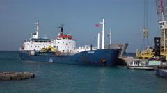 Grand Cayman port Vistague dirt aggregate cargo carrier ship 4K Stock Footage
