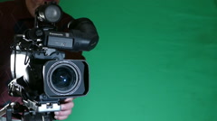 Camcorder on a Green Background Stock Footage