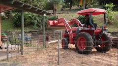 Male on tractor rearing back with caution - stock footage