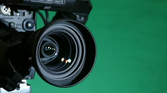 Camcorder on a Green Background - stock footage