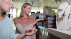 4K 2 female friends shopping together in small boutique shop. - stock footage