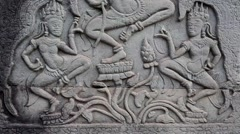 Bas-relief on the ancient wall in Angkor Thom temple complex in Cambodia Stock Footage