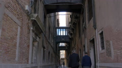 Small bridges connecting buildings on a narrow street in Venice - stock footage
