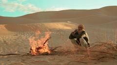 sahara man near a fire - stock footage