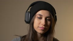 Young woman listening to headphones with smartwatch on Stock Footage