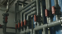 New plastic pipes and colorful equipment in industrial boiler room Stock Footage