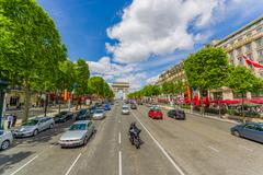 Beautiful summer view of Champs Elysees and Arc de Triomphe, Paris, France Stock Photos
