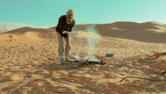 Sahara man cooking bread Stock Footage