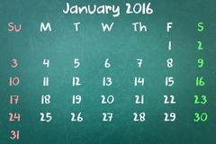 Green blackboard wall texture with a word Calender 2016 January - stock photo