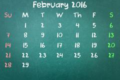 Green blackboard wall texture with a word Calender 2016 February - stock photo