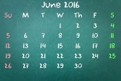 Green blackboard wall texture with a word Calender 2016 June Stock Photos