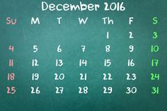Green blackboard wall texture with a word Calender 2016 December - stock photo