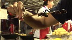 American man eating scorpions, China Stock Footage