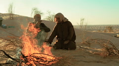 Sahara men near a fire Stock Footage