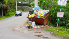 Small town sideroad with trash deposit in Brazil - stock footage
