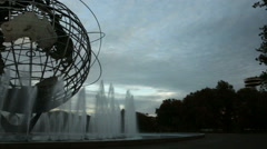 Panning shot of the famous Unisphere globe at sunset water fountains Queens NYC Stock Footage