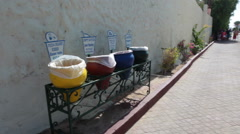 Color wastebaskets for separation of garbage are on passages of hotel. Egypt Stock Footage
